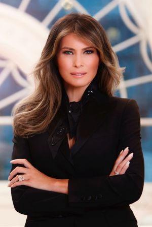 Melania's choice of jewellery in the portrait has been the centre of criticism from many social media users and ...