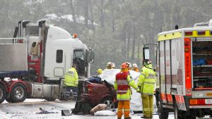 An accident involving a sedan and a truck on the Princes Highway near Berry, NSW, last year.