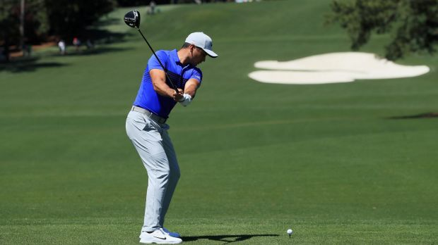 Day plays a shot from the eighth tee during a practice round at Augusta on Tuesday.