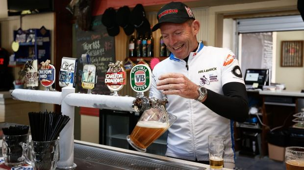 Former Prime Minister Tony Abbott, pictured during this year's Pollie Pedal tour, says cutting immigration would ease ...