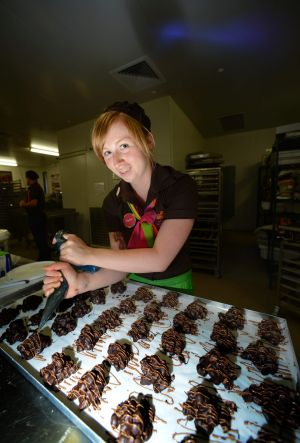 Danni Smyth places finishing touches on Yarra Valley Chocolaterie chocolates.