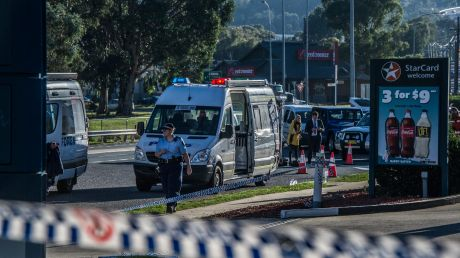 Police and emergency services at the scene of the Queanbeyan service station stabbing.