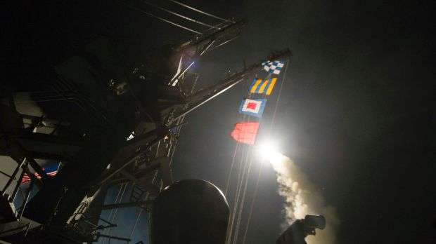 The USS Ross fires a tomahawk missile at Syria.