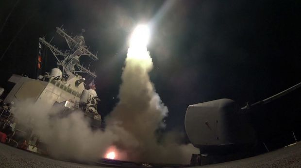 The guided-missile destroyer USS Porter (DDG 78) launches a tomahawk missile towards a Syrian air base in retaliation ...