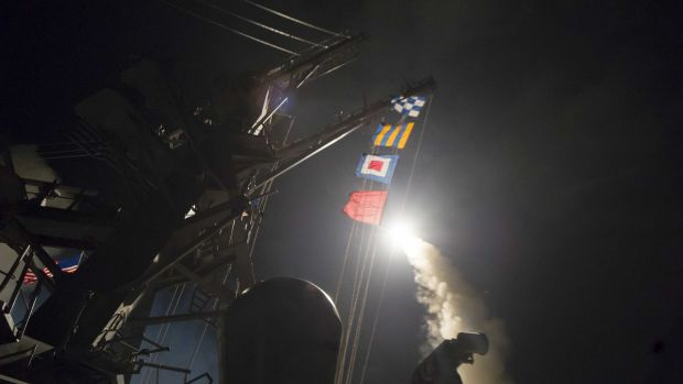 The guided-missile destroyer USS Ross fires a Tomahawk land attack missile towards Syria on April 7.