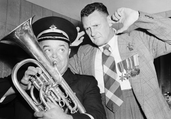 A marching band don't get the warm reception they were hoping for on entering a Sydney hotel following the 1958 march.