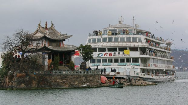 A tourist cruise boat berths at Little Putuo Temple on Erhai Lake in Dali.