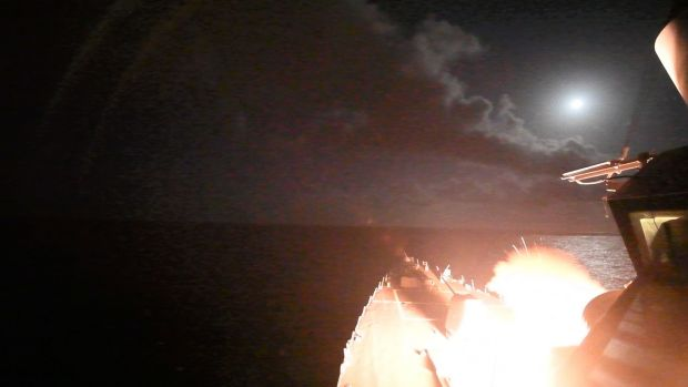 The guided-missile destroyer USS Porter (DDG 78) launches a Tomahawk land attack missile towards Syria on Friday.