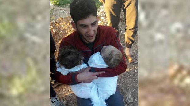 A man holds his twin babies who were killed during the chemical weapons attack in Syria. Trump was said to be impacted ...