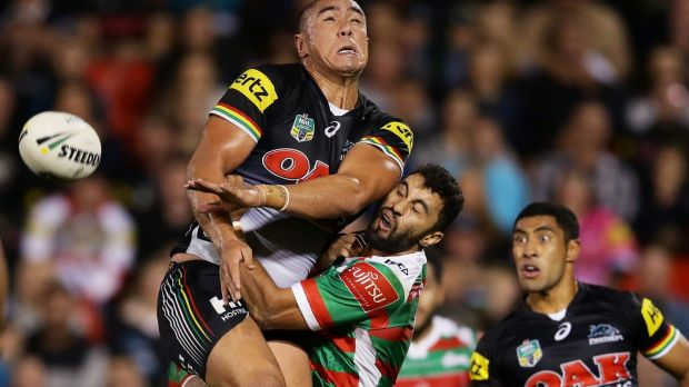 Bomb squad: Leilani Latu runs into Alex Johnston of the Rabbitohs contesting a high ball.
