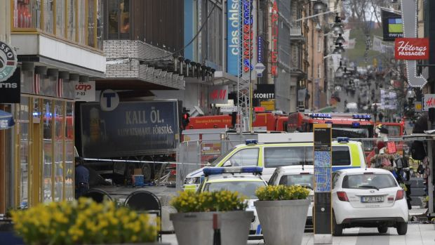 A truck after it came to rest in a Stockholm department store after killing three people en route.