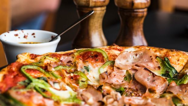 The energy content of pizza consumed in a single sitting has risen by 66 per cent.