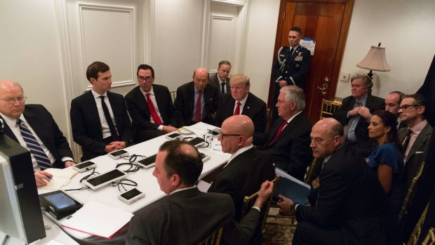 President Donald Trump receives a briefing on the Syria military strike from his National Security team at Mar-a-Lago ...