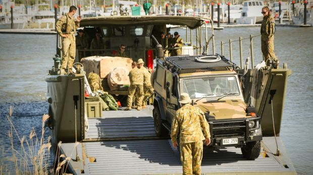 An Australian Army Mercedes Benz G-Wagon disembarks landing craft at the Keppel Bay Marina, Yeppoon, Central Queensland, ...
