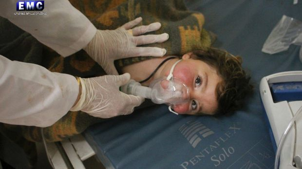 A Syrian doctor treats a child following the chemical attack in Khan Sheikhoun, Syria.