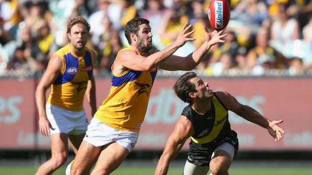 Eagle eye: Jack Darling competes with Alex Rance.