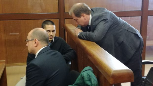 John Zakhariev, centre, speaks with his Australian lawyer Jay Williams, right, in court in Sophia on Friday April 7.