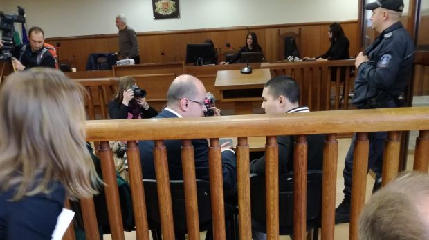 Bulgarian lawyer Histro Botev speaks with his client Australian John Zakhariev, right seated, in court in Sofia on Friday.