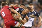 Rory Arnold of the Brumbies is tackled by Scott Higginbotham of the Reds .