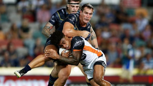 Heavy attention: Kevin Naiqama of the Tigers is tackled by the Cowboys defence.