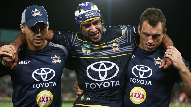 Sorry sight: Johnathan Thurston is helped off the field.