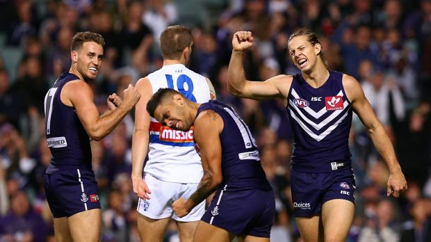 The Dockers celebrate an upset win over the reigning premiers.