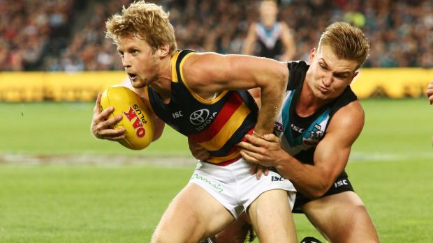 Full pressure: Power's Ollie Wines tackles Rory Sloane.
