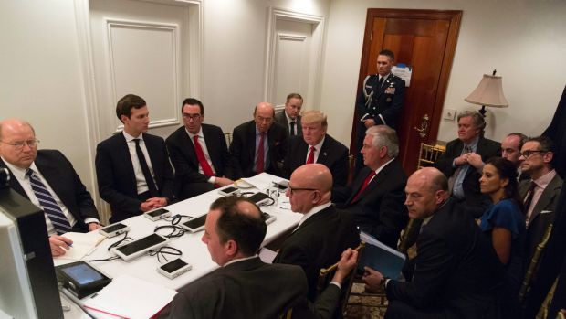 Donald Trump and members of his administration are briefed on the strike on an air base in Syria.