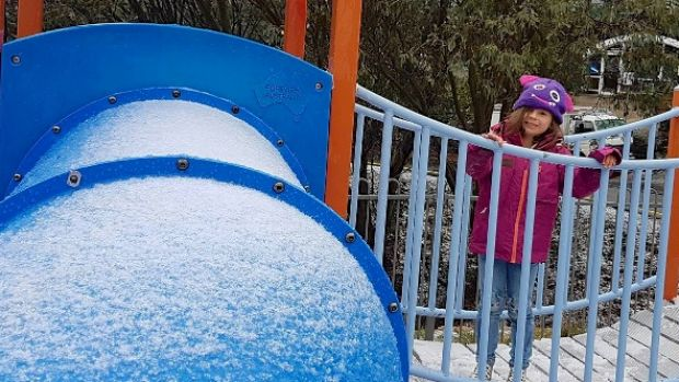 Lea Clementine enjoys the first snow of autumn at Falls Creek.
