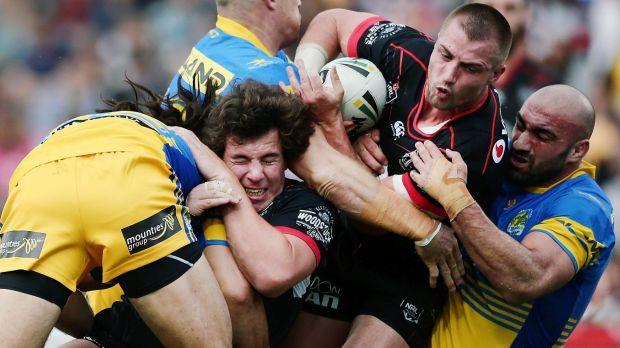 Thwarted: Kieran Foran gets caught in a scrum of bodies.