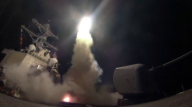 The guided missile destroyer USS Porter launches a Tomahawk missile as the US blasted a Syrian air base with a barrage ...