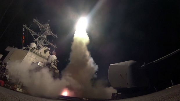 The destroyer USS Porter launches a Tomahawk missile at a Syrian air base last week.