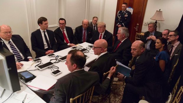 US President Donald Trump receives a briefing on the Syria military strike from his National Security team at Mar-a-Lago ...