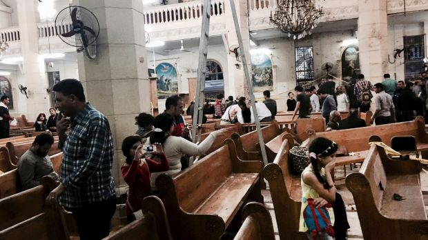 People look at damage inside St George's church after a suicide bombing in the Nile Delta town of Tanta in April.