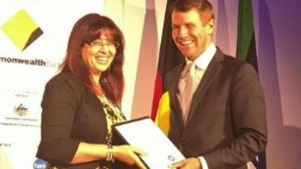 Eman Sharobeem receives her commendation in the Australian of the Year Award in November 2014 from then-NSW premier Mike ...