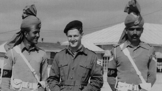 Ian Stewart (centre) flanked by United Nations military police during a press tour of Panmunjom, Korea in 1953.