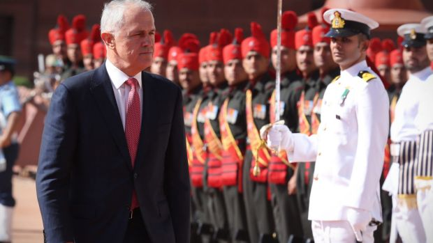 Prime Minister Malcolm Turnbull is received by Indian Prime Minister Narendra Modi at a ceremonial welcome at the ...