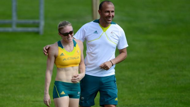 Sally Pearson shares a laugh with athletics team coach Eric Hollingsworth in 2012.