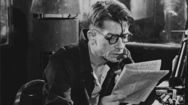 """Winston (actor John Hurt) at work in the Ministry of Truth where he re-writes history. From the British film """"1984"""" (1984)."""