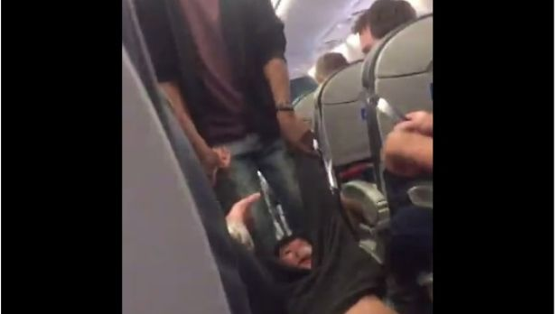 A fellow United passenger's video showed the man being dragged through the aisle.