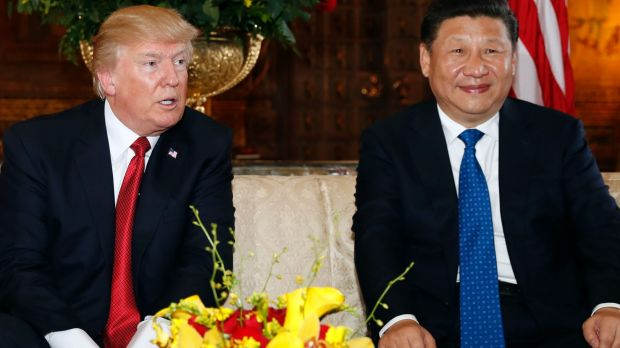 US President Donald Trump, pictured with Chinese President Xi Jinping at Mar-a-Lago in Florida, is cutting overseas ...