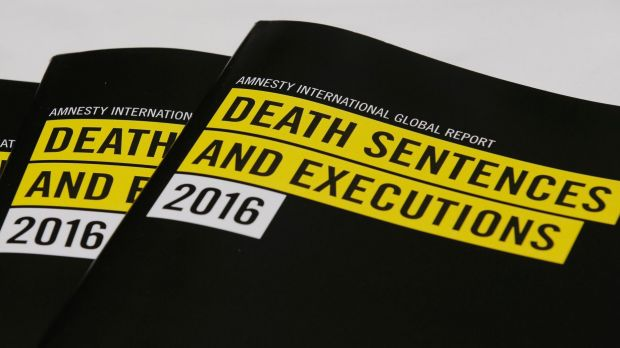 Copies of reports on the death penalty are displayed during a press conference of Amnesty International in Hong Kong.