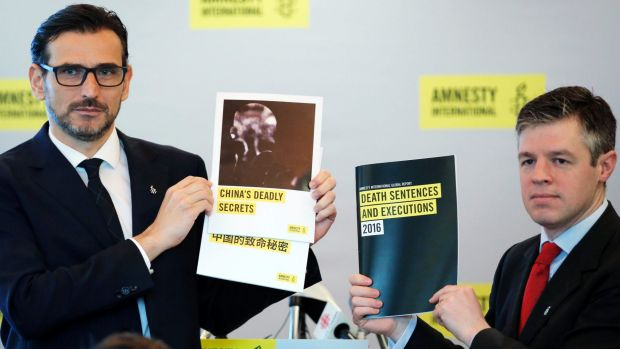 Amnesty International East Asia Director Nicholas Bequelin, left, and Deputy Director of Global Issues James Lynch hold ...
