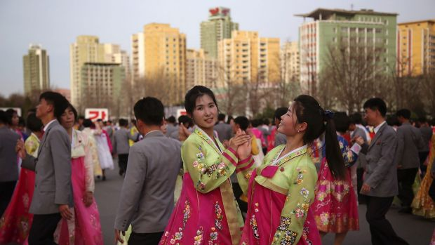 North Korean students participate in a mass dance event on Sunday to mark the late North Korean leader Kim Jong-Il's ...