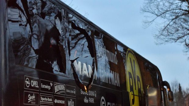 A window of Dortmund's team bus is damaged after an explosion.