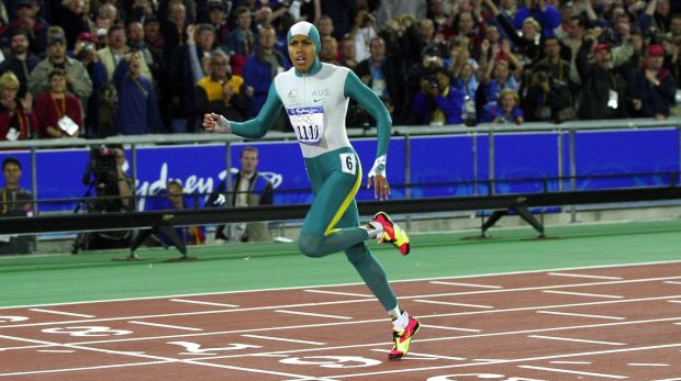 Cathy Freeman wins gold in the 400m at the Sydney Olympics.