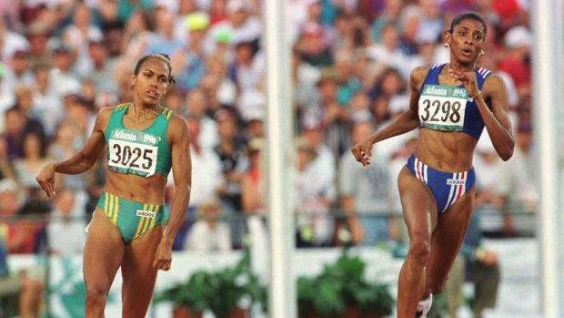 Australian runner Cathy Freeman in action against French runner Jose-Marie Perec at the Atlanta Olympics, where she won ...