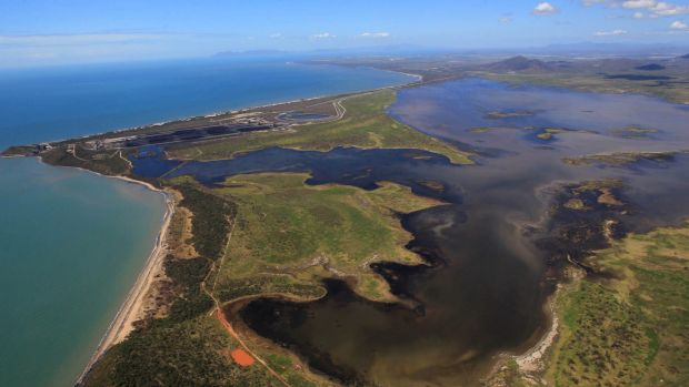 A picture of the Abbot Point coal loading facility showing coal water run-off moving north-west into the wetlands and ...