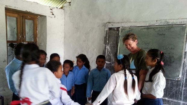Supporters of Canberra charity REACH for Nepal also spend time with local children, including in the classroom.