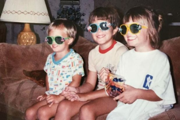 """Mandy Moore (right) shared this throwback snap with """"goofy brothers"""" Kyle and Scott on Instagram to celebrate National ..."""